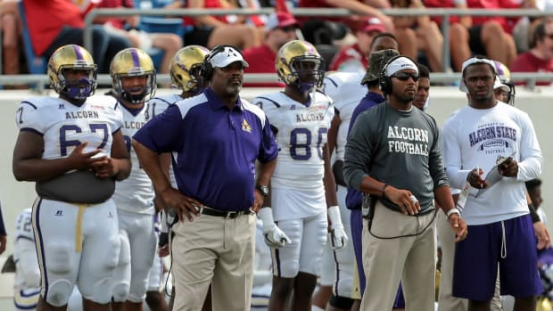 Alcorn State's head coach Fred McNair, front left, surveys the field during the second half of an NCAA football game against Arkansas on Saturday, Oct. 1, 2016, in Little Rock, Ark. Arkansas beat Alcorn State, 52-10. (AP Photo/Chris Brashers)