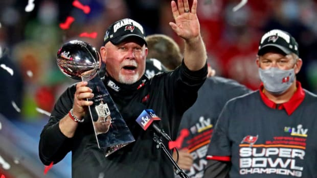 Feb 7, 2021; Tampa, FL, USA;  Tampa Bay Buccaneers head coach Bruce Arians celebrates with the Vince Lombardi Trophy after the Tampa Bay Buccaneers beat the Kansas City Chiefs in Super Bowl LV at Raymond James Stadium.  Mandatory Credit: Mark J. Rebilas-USA TODAY Sports