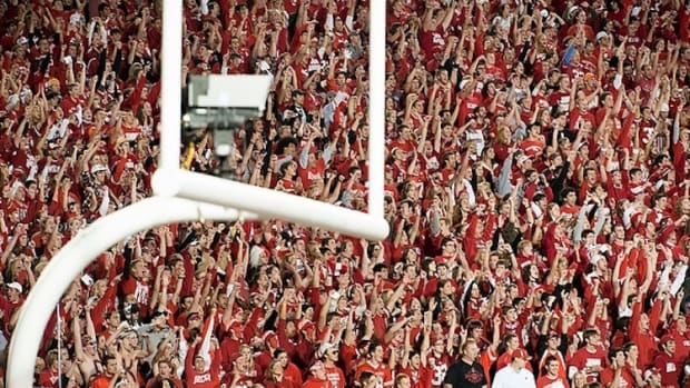 Badger fans in the student section cheer as the Wisconsin Badgers football team plays the No. 1-ranked Ohio State Buckeyes during a night game at Camp Randall Stadium at the University of Wisconsin-Madison on Oct. 16, 2010. Tens of thousands of fans took to the field in victorious celebration after Wisconsin won the game, 31-18. (Photo by Jeff Miller/UW-Madison)