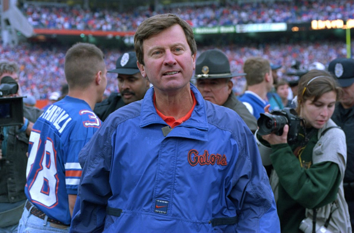 25 NOV 1995:  HEAD COACH STEVE SPURRIER OF THE UNIVERSITY OF FLORIDA WALKS ON THE FIELD FOLLOWING THE GATORS 25-24 VICTORY OVER THE FLORIDA STATE SEMINOLES AT FLORIDA FIELD IN GAINESVILLE, FLORIDA. Mandatory Credit: ANDY LYONS/ALLSPORT