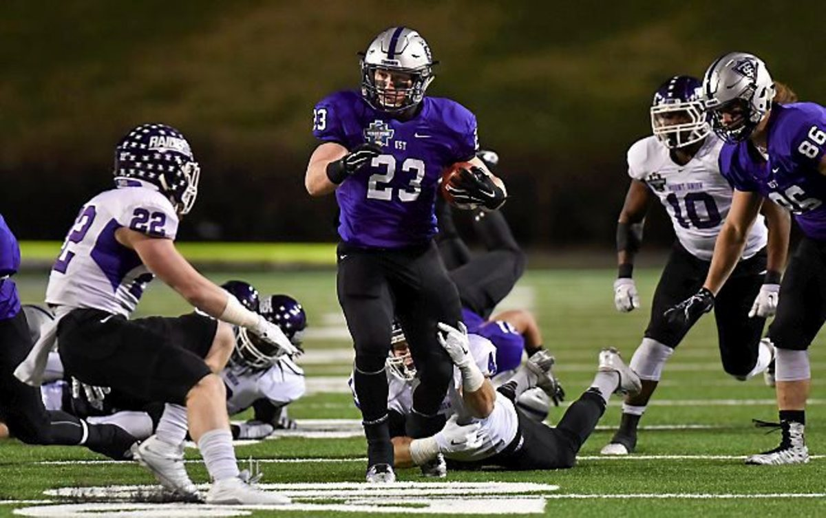 St. Thomas running back Jordan Roberts (23) carries the ball against Mount Union during the first half of the the NCAA Division III football championship game in Salem, Va., Friday, Dec. 18, 2015. (AP Photo/Michael Shroyer)