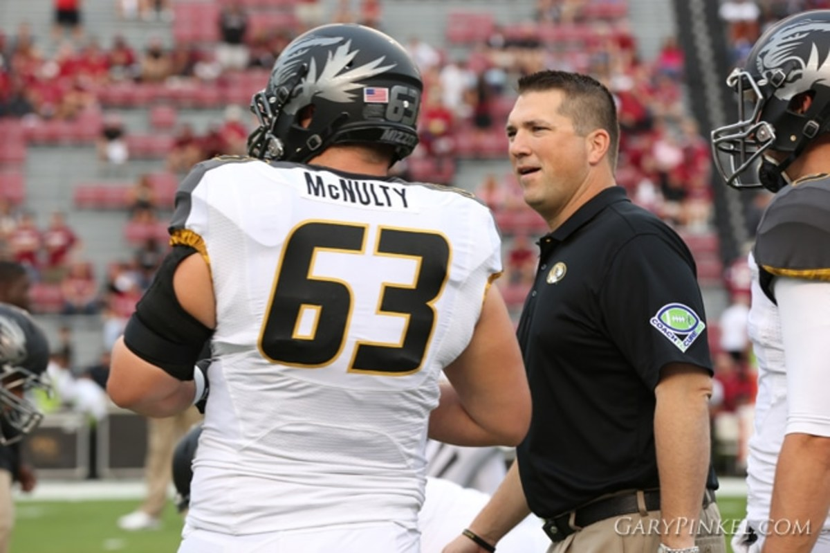 Mizzou Football Offensive Line Coach Josh Henson coaches up Offensive Lineman Brad McNulty before the Tigers take on the University of South Carolina Gamecocks in Williams-Brice Stadium on Saturday, September 27, 2014 in Columbia, S.C.