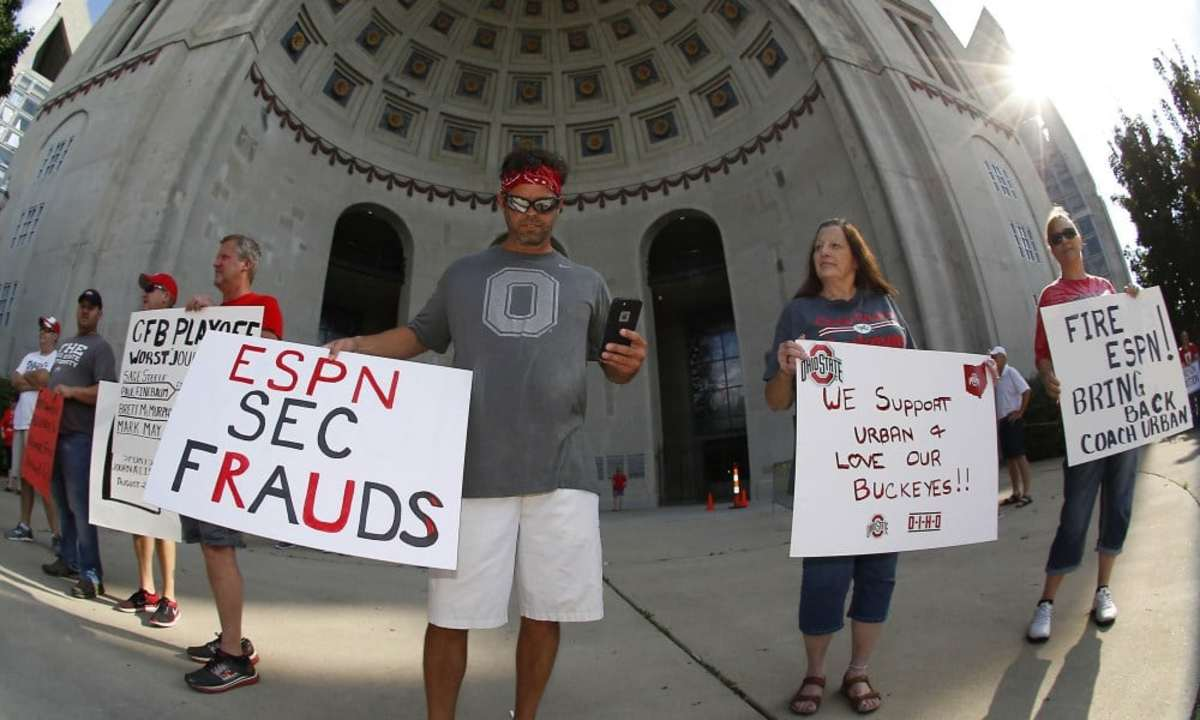 Aug 6, 2018; Columbus, OH, USA; Damon Jordan (left) of Hilliard, Ohio supports Ohio State Buckeyes coach Urban Meyer at a rally held at Ohio Stadium on Monday at The North Rotunda. Mandatory Credit: Joe Maiorana-USA TODAY Sports ORG XMIT: USATSI-384638 ORIG FILE ID:  20180806_sal_mb3_3978.JPG