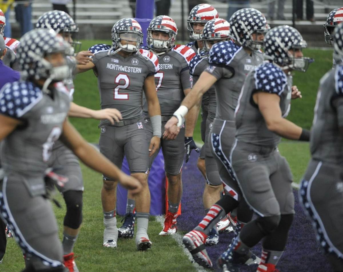 Nov 16, 2013; Evanston, IL, USA; Northwestern Wildcats quarterback Kain Colter (2) wears the wounded warrior uniform before the game against the Michigan Wolverines at Ryan Field. Mandatory Credit: David Banks-USA TODAY Sports