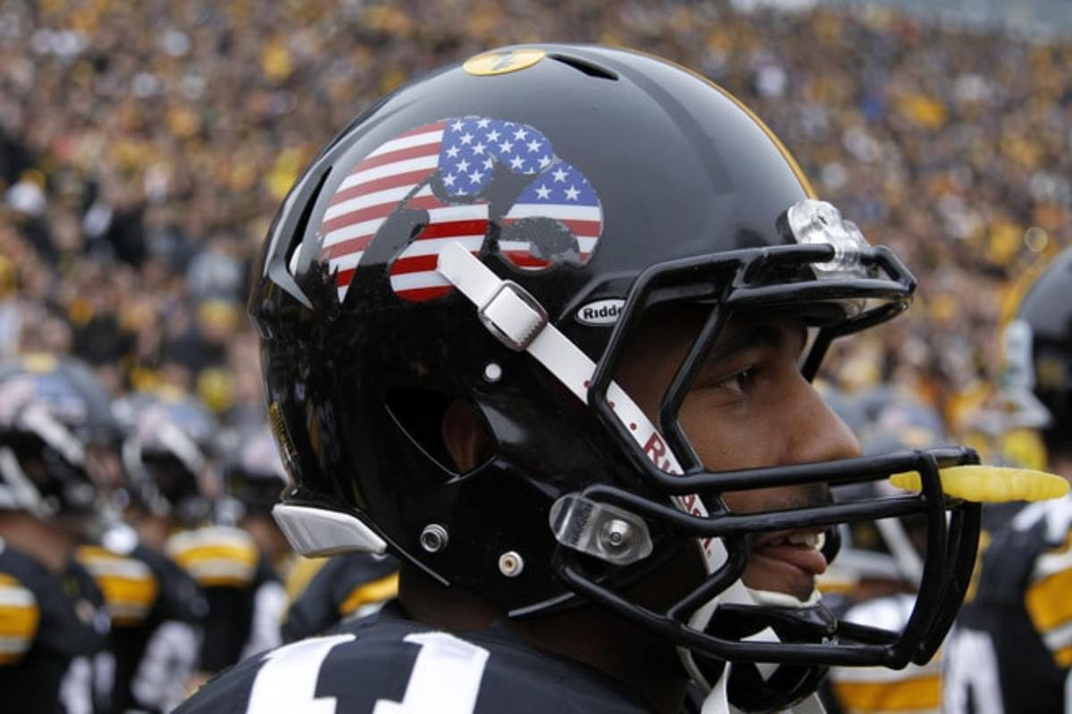 IOWA CITY, IA - NOVEMBER 5: Detail view of special American flag decal worn on the Iowa Hawkeyes helmets before the game against the at Michigan Wolverines at Kinnick Stadium on November 5, 2011 in Iowa City, Iowa. Iowa won 24-16. (Photo by Joe Robbins/Getty Images)